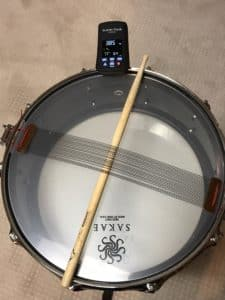 tune-bot on a Drum